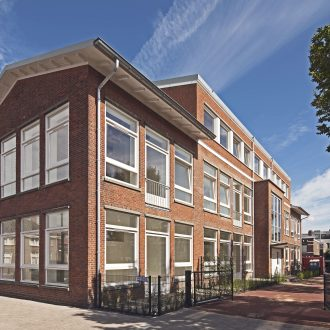 Herbestemming Dr de Visserschool tot appartementen in Den Haag